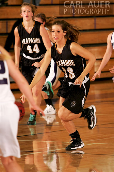 December 10, 2012: A Arapahoe girls varsity basketball player brings the ball up the court in her game against Arvada West.