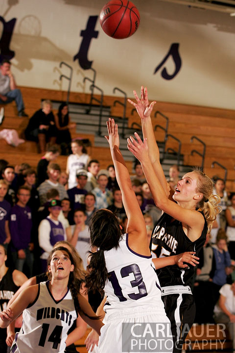 December 10, 2012: A Arapahoe girls varsity basketball player takes a shot in her game against Arvada West.