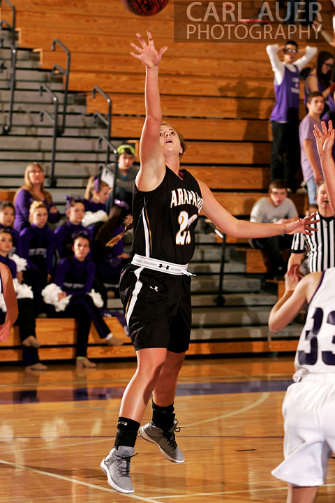 December 10, 2012: A Arapahoe girls varsity basketball player attempts a lay-up in her game against Arvada West.