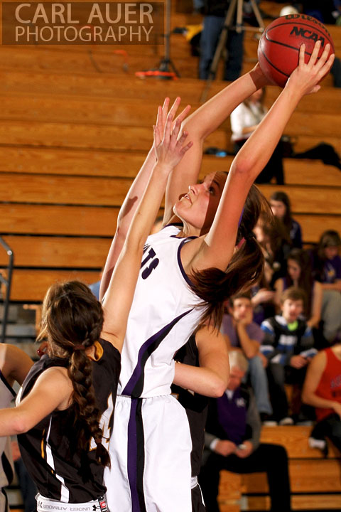 December 10, 2012: A Arvada West girls varsity basketball player grabs a rebound in her game against Arapahoe.