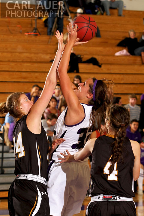 December 10, 2012: A Arvada West girls varsity basketball puts a shot up after she grabbed a rebound in her game against Arapahoe.