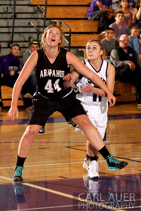 December 10, 2012: A Arvada West girls varsity basketball player is blocked out by a Arapahoe player in their game Monday night,