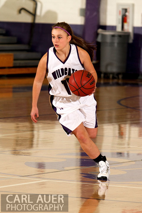 December 10, 2012: A Arvada West girls varsity basketball dribbles the ball up the court in her game against Arapahoe.
