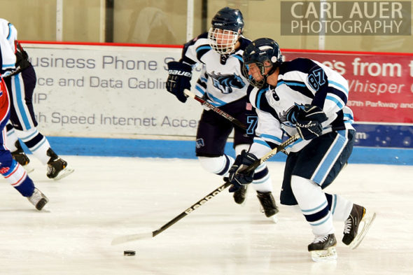 December 18, 2012: A Ralston Valley hockey player controls the puck in the game between Cherry Creek and Ralston Valley at the APEX Ice Arena on Tuesday night.