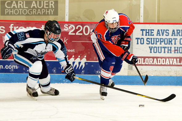 December 18, 2012: A Ralston Valley hockey player and a Cherry Creek player chase after the puck in the game between Cherry Creek and Ralston Valley at the APEX Ice Arena on Tuesday night.