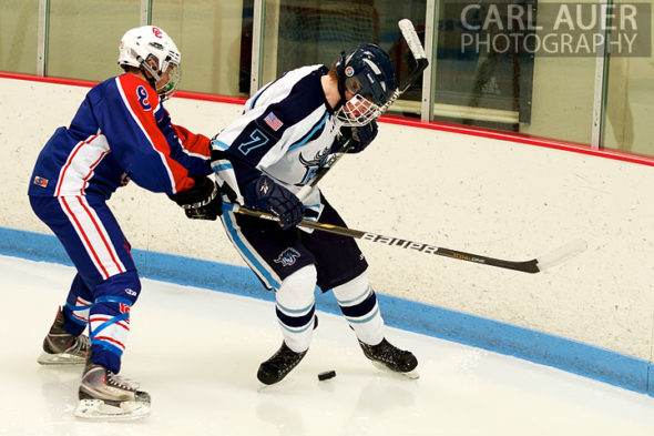 December 18, 2012: A Ralston Valley hockey player tries to get control of the puck as a Cherry Creek player tries to knock the puck away in the game between Cherry Creek and Ralston Valley at the APEX Ice Arena on Tuesday night.