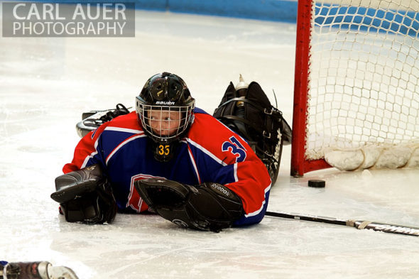 December 18, 2012: The Cherry Creek goalie lies on the ice after allowing a goal in the game between Cherry Creek and Ralston Valley at the APEX Ice Arena on Tuesday night.
