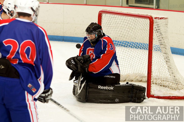 December 18, 2012: The Cherry Creek goalie tries to grab a deflected shot in the game between Cherry Creek and Ralston Valley at the APEX Ice Arena on Tuesday night.