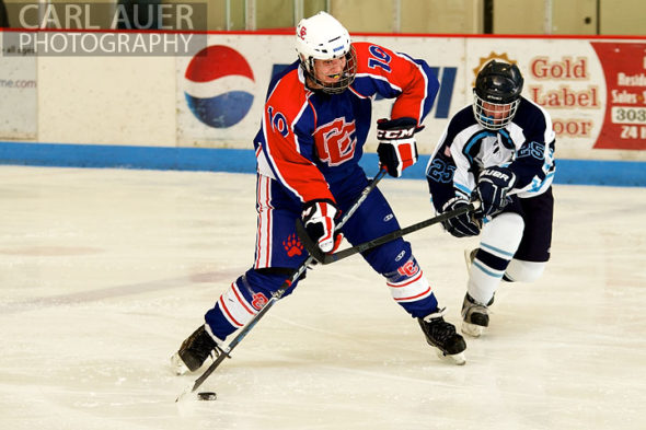 December 18, 2012: A Cherry Creek player slaps a shot in the game between Cherry Creek and Ralston Valley at the APEX Ice Arena on Tuesday night.