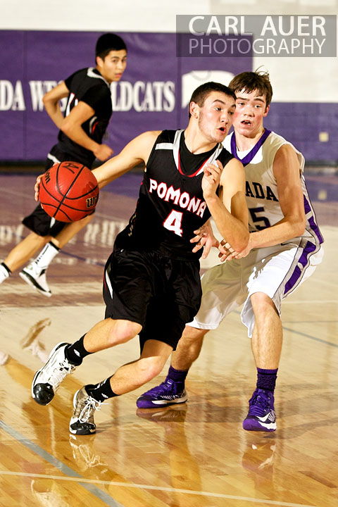 December 20, 2012: Pomona Panther senior guard Mitch Colin (4) drives the ball past Arvada West Wildcat sophomore Thomas Neff (15) in the game between Pomona and Arvada West on Thursday night at Arvada West High School.