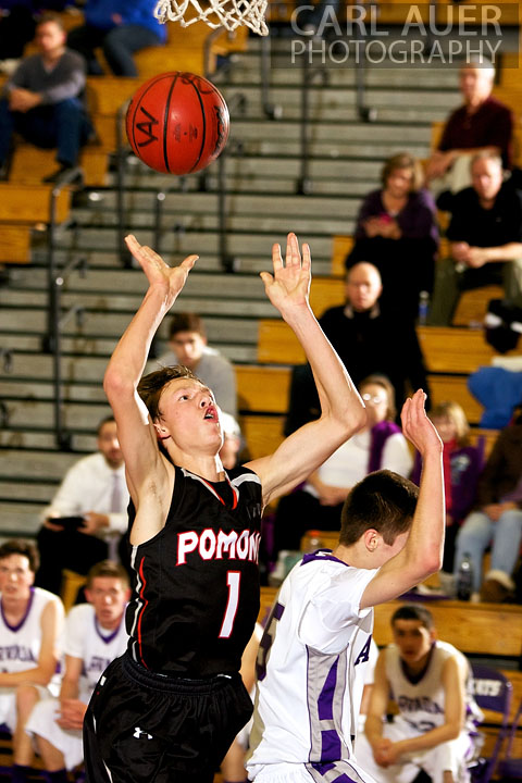 December 20, 2012: Pomona Panther sophomore Javis Larson (1) throws a shot up in the game between Pomona and Arvada West on Thursday night at Arvada West High School.