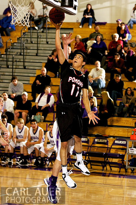 December 20, 2012: Pomona Panther junior Justo Camara (11) takes a shot baseline in the game between Pomona and Arvada West on Thursday night at Arvada West High School.