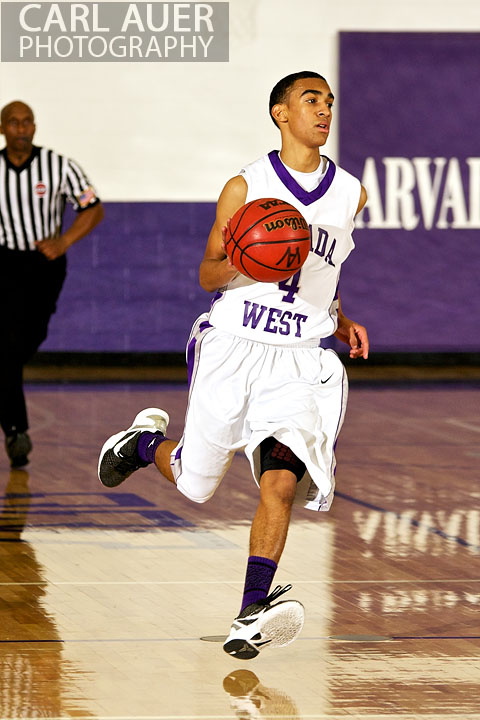 December 20, 2012: Arvada West Wildcat sophomore guard Dhillon Greene (4) brings the ball up court in the game between Pomona and Arvada West on Thursday night at Arvada West High School.