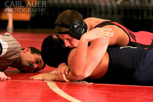 December 12th, 2012: The referee gets a close look at the action as a Arvada wrestler attempts to pin a Mullen wrestler in their meet at Arvada Senior High School