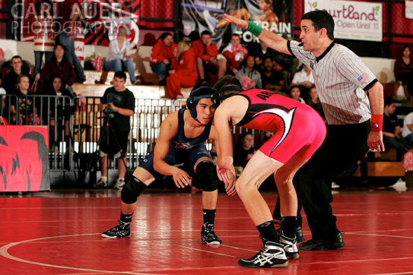 December 12th, 2012: The referee signals the start of a match between a Arvada wrestler and a Mullen wrestler in their meet at Arvada Senior High School