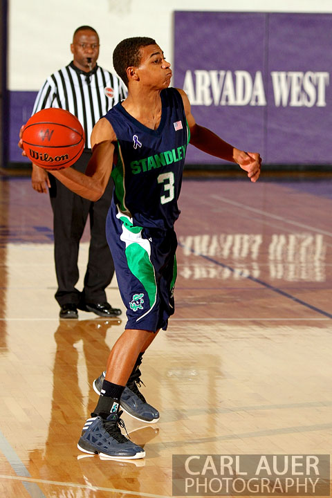 January 9th, 2013:  Standley Lake Gator freshman Eric Turner rifles a pass into the lane against Arvada West on Wednesday night.