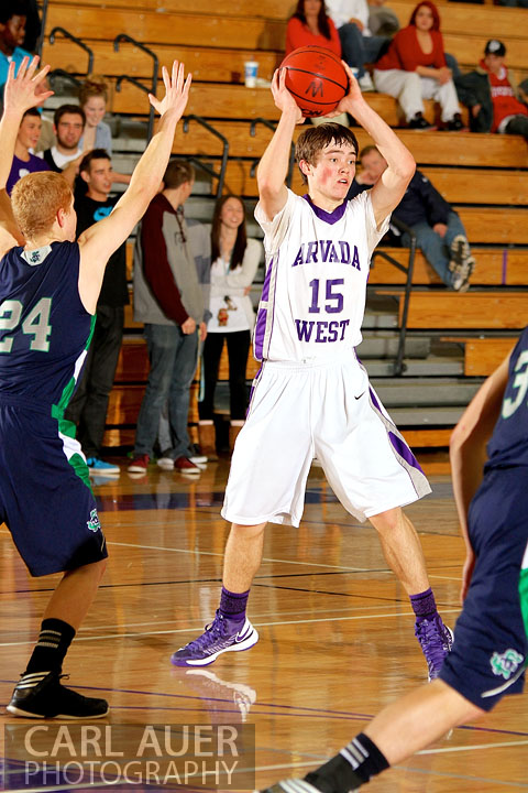 January 9th, 2013:  Arvada West Wildcat sophomore Thomas Neff (15) looks for a pass in the game against the Standley Lake Gators at Arvada West High School on Wednesday night.
