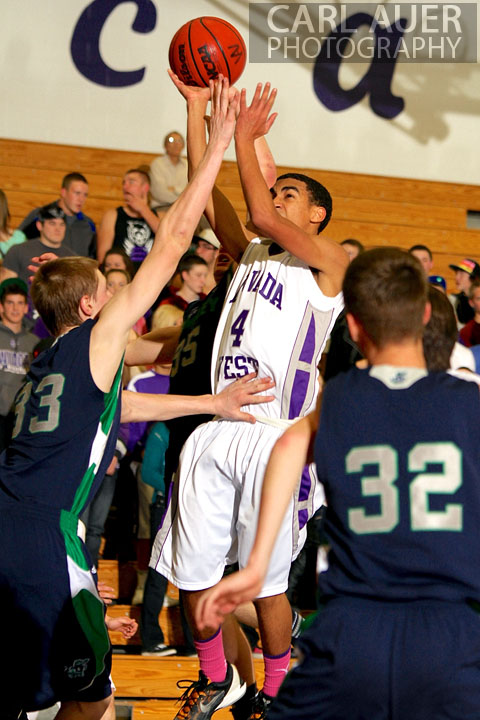 January 9th, 2013:  Arvada West Wildcat sophomore guard Dhillon Greene (4) elevates for a shot against the Standley Lake Gators on Wednesday night.
