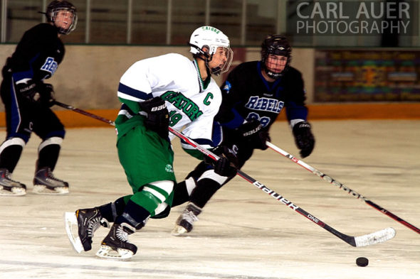 January 4th, 2013: A Standley Lake Gator takes the puck out of the zone in the game against the Columbine Rebels at the Ice Center at the Promenade in Westminster, CO on Friday night.