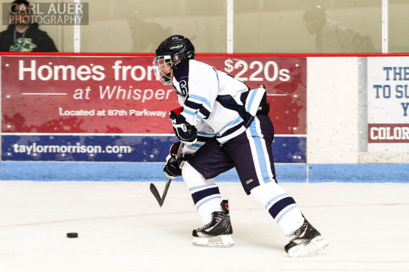 February 22, 2013: Arvada, Colorado - Ralston Valley Mustang senior forward Matt Morelli brings the puck up the ice in the playoff game against Bishop Machebeuf at the Apex Center in Arvada