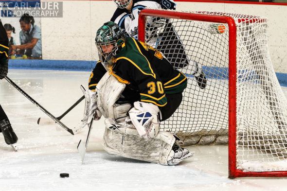 February 22, 2013: Arvada, Colorado - Bishop Machebeuf goalie Alan Rickli attempts to make a stop of a shot by a Ralston Valley Mustang player in their playoff game at the Apex Center in Arvada