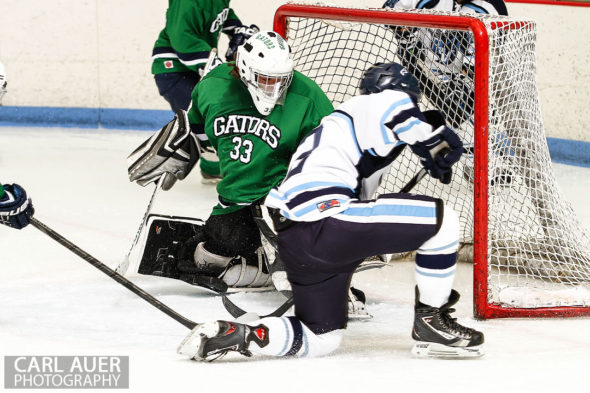 February 23, 2013: Arvada, Colorado - Standley Lake Gators goalie Tyler Goff attempts to stop of a shot by a Ralston Valley Mustang player in their playoff game at the Apex Center in Arvada