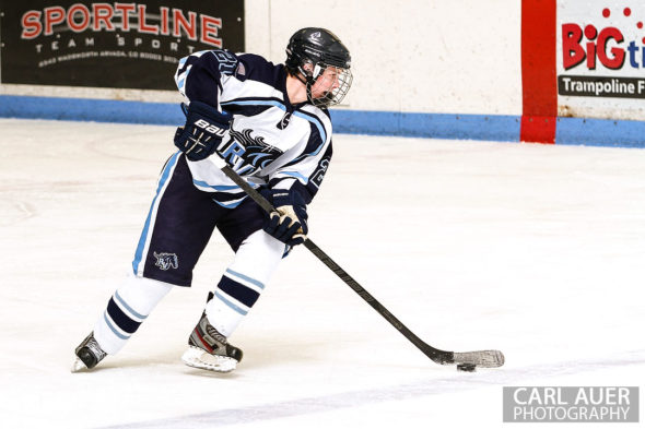 February 23, 2013: Arvada, Colorado - Ralston Valley Mustang sophomore forward Ian Snedden controls the puck in the playoff game against Standley Lake at the Apex Center in Arvada