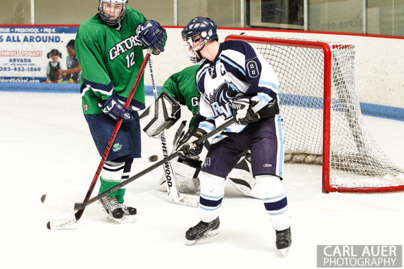February 23, 2013: Arvada, Colorado - Ralston Valley Mustang senior forward Tanner West attempts to flip the puck backwards into the Standley Lake goal in their playoff game at the Apex Center in Arvada