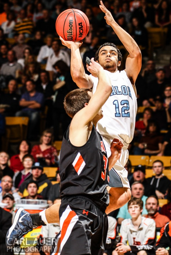 March 16th, 2013: Valor Christian Eagles junior guard Marcus Wilson (12) hangs in the air for his shot attempt over Lewis-Palmer Rangers senior guard Tyler Owens (35) in the CHSAA 4A State Championship game at the Coors Events Center in Boulder, Colorado
