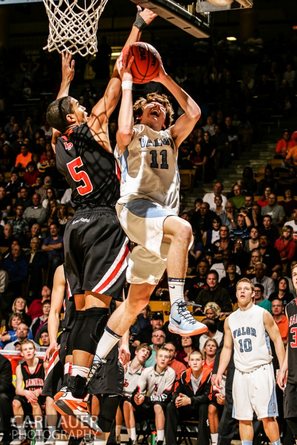 March 16th, 2013: Valor Christian Eagles junior guard Paden Mueller (11) attempts a shot past Lewis-Palmer Rangers senior guard/forward Jordan Scott (5) in the CHSAA 4A State Championship game at the Coors Events Center in Boulder, Colorado