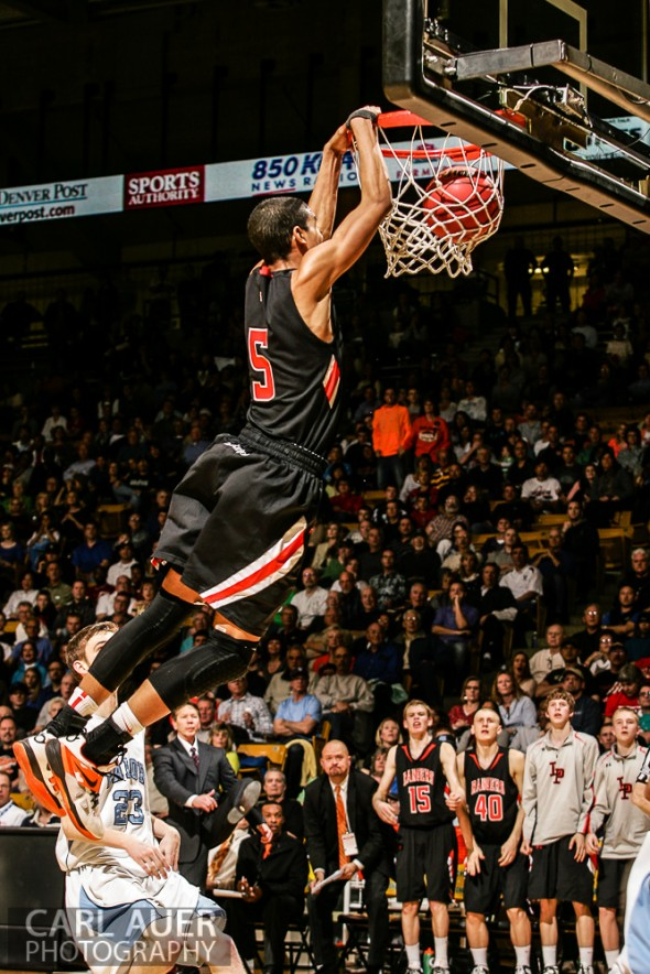 March 16th, 2013:  Lewis-Palmer Rangers senior guard/forward Jordan Scott (5) sends the ball through the hoop with a thundering two handed dunk in the CHSAA 4A State Championship game against the Valor Christian Eagles at the Coors Events Center in Boulder, Colorado