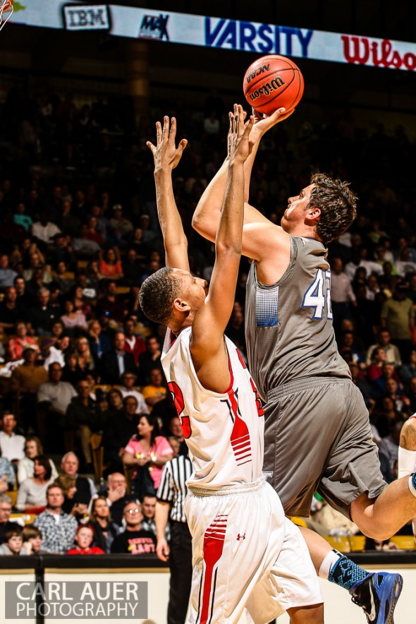 March 15, 2013: Legend Titans junior Zach Mihalicz attempts a shot over Denver East Angels junior forward Tyre Robinson (32) in the CHSAA 5A Final Four game at the Coors Events Center in Boulder, Colorado