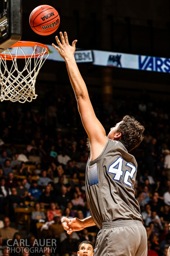 March 15, 2013: Legend Titans junior Zach Mihalicz attempts a shot in the CHSAA 5A Final Four game against the Denver East Angels at the Coors Events Center in Boulder, Colorado