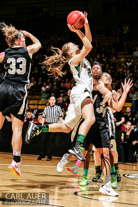 March 16th, 2013: D'Evelyn Jaguars sophomore guard Morgan Ducklow (24) flies between the Pueblo South defense in the Championship game of the CHSAA 4A State Tournament at the Coors Events Center in Boulder, Colorado