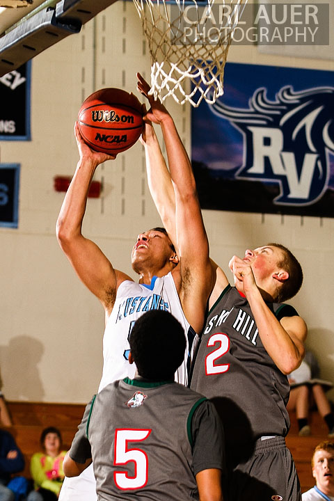 February 27th 2013: Arvada, Colorado - Ralston Valley Mustang junior Zac Stevens (5) attempts a lay up past Smoky Hill's Trent Clay in the game at Ralston Valley High School.