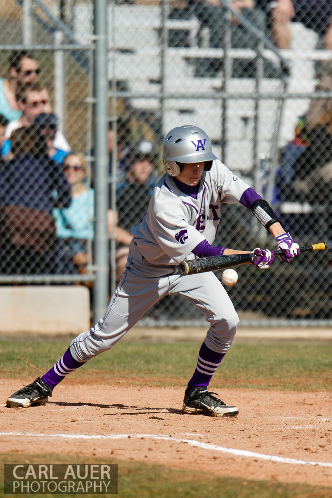 April 24th, 2013: A Arvada West player lays down a bunt in the Wildcats game against the Ralston Valley Mustangs at Ralston Valley High School in Arvada, Colorado