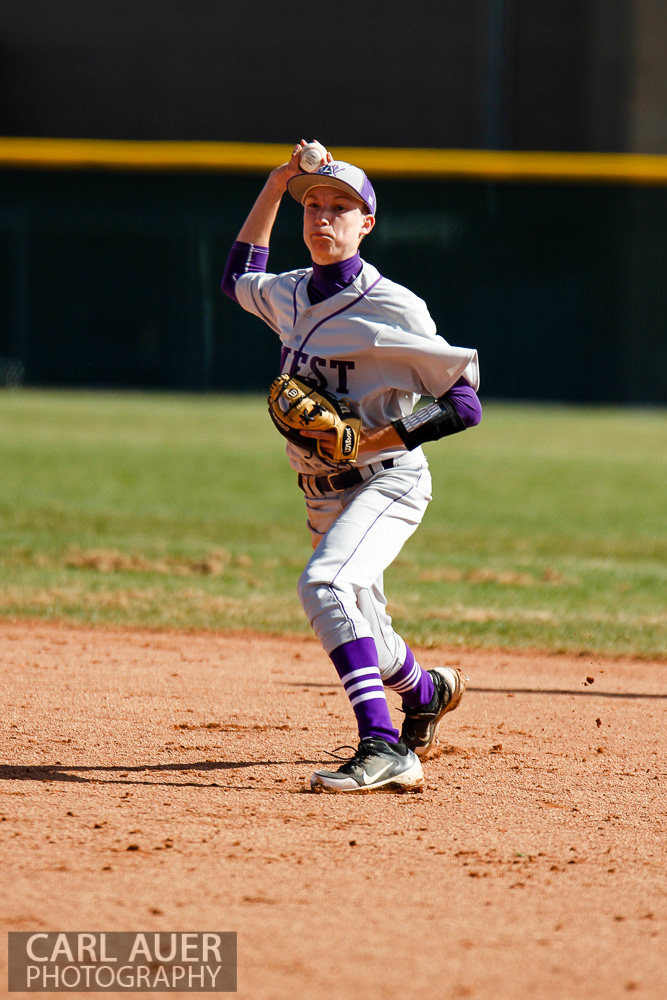 April 24th, 2013: The Arvada West second baseman sets to throw a Ralston Valley Mustang runner out at Ralston Valley High School in Arvada, Colorado
