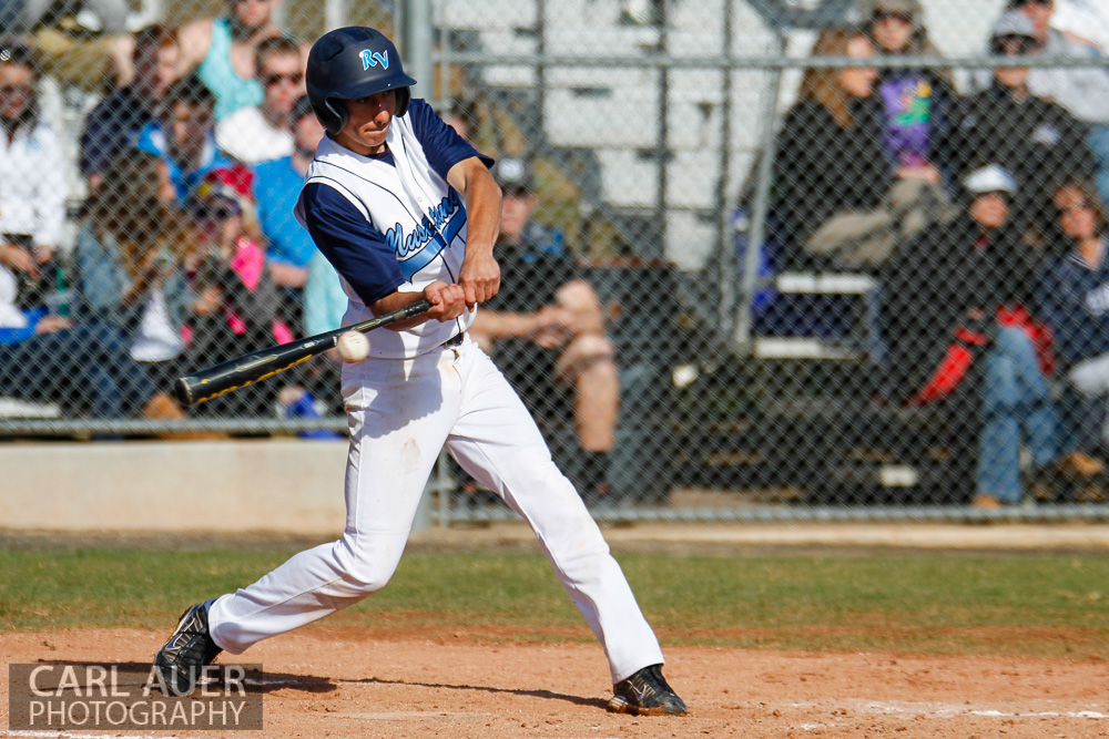 April 24th, 2013: A Ralston Valley Mustangs batter makes contact with a pitch in the game against Arvada West at Ralston Valley High School in Arvada, Colorado