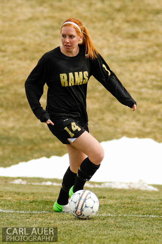 April 25th, 2013: Green Mountain Ram Claire Miles (14) gathers up the ball on the end line in the Ram's game against the Arvada Bulldogs at the North Area Athletic Complex in Arvada, Colorado