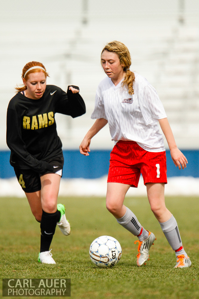 April 25th, 2013: Arvada Bulldog Aspen Beckwith (1) takes control of the ball in Arvada High Schools game against the visiting Green Mountain Rams at the North Area Athletic Complex in Arvada, Colorado