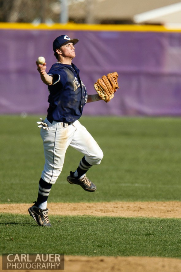 April 26th, 2013: Columbine Rebels shortstop Austin Anderson (24) attempts to throw out a Arvada West Wildcat batter at first base in the league game at Arvada West High School in Arvada, Colorado