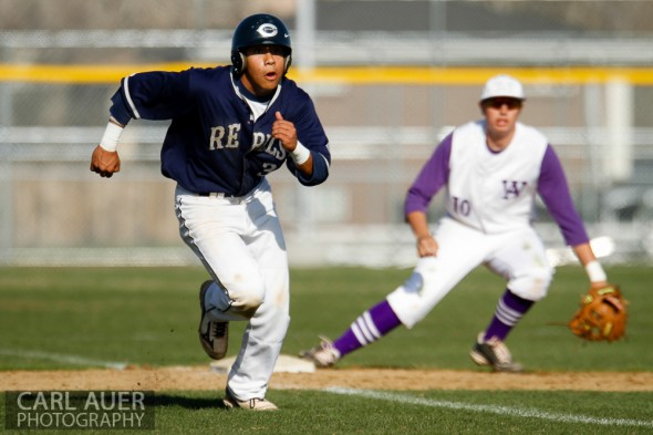 April 26th, 2013: Columbine Rebels baserunner Donny Ortiz (3) breaks towards home in the game against the Arvada West High School Wildcats in Arvada, Colorado