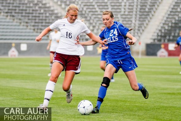 May 22, 2013 - A Broomfield Eagles player attempts to dribble the ball past Cheyenne Mountain Indians junior defender Savannah Boarman (16) in the CHSAA 4A Girls Soccer Championship Game at Dick's Sporting Goods Park in Commerce City, Colorado