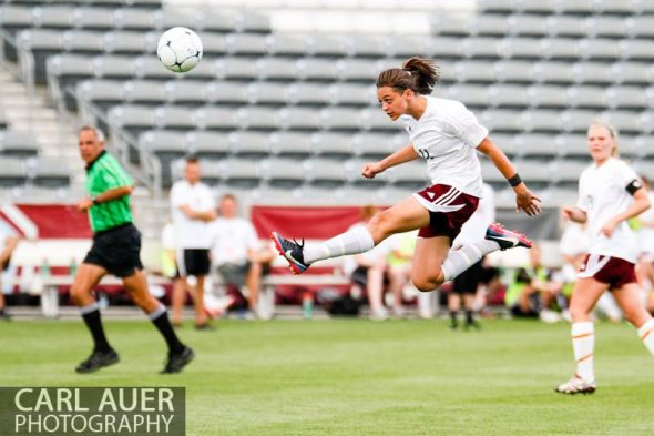 May 22, 2013 - Cheyenne Mountain Indians junior defender Tori Burnett (11) flies through the air for a kick in the CHSAA 4A Girls Soccer Championship Game against the Broomfield Eagles at Dick's Sporting Goods Park in Commerce City, Colorado