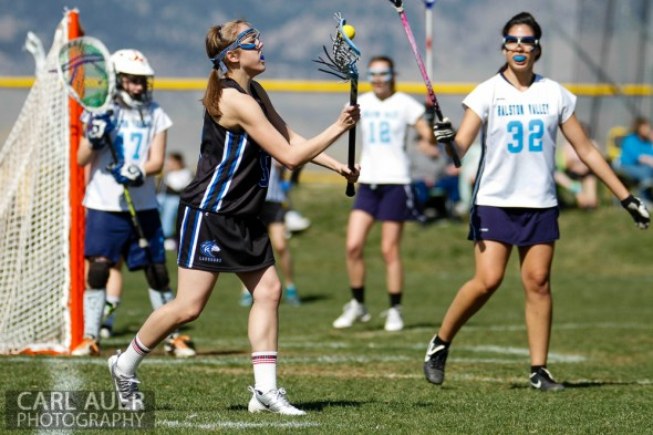 April 27th, 2013: Grandview Wolves sophomore Katie Sengenberger (5) makes a pass near the Ralston Valley Mustang's goal in the game at Ralston Valley High School on Saturday morning in Arvada, Colorado