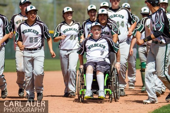 May 17th 2013: The Fleming Wildcats run wheelchair bound senior teammate Jeremy Richhard-Kind (7) around the bases after defeating the Holly Wildcats 5-3 in the CHSAA 1A Baseball final at All Star Park in Lakewood, Colorado
