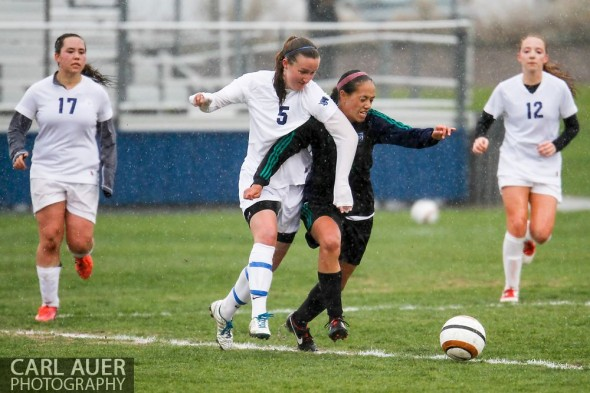 May 8th, 2013: Ralston Valley Mustang junior Maddie Allensworth (5) and ThunderRidge Grizzlies freshman Mealii Enos (14) battle for control of the ball in the CHSAA 5A Soccer Playoff game at the North Area Athletic Complex in Arvada, Colorado