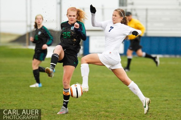 May 8th, 2013: Ralston Valley Mustang freshman Alaina Snedden (7) flies into intercept a pass by ThunderRidge Grizzlies senior Maddie Shelton (25) in the CHSAA 5A Soccer Playoff game at the North Area Athletic Complex in Arvada, Colorado