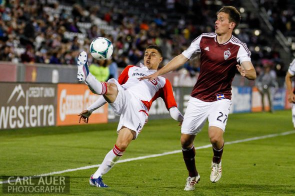 May 4th, 2013 - Toronto FC midfielder Luis Silva (11) attempts to clear the ball away from Colorado Rapids midfielder Shane O'Neill (27) in the MLS match between the Toronto FC and the Colorado Rapids at Dick's Sporting Goods Park in Commerce City, CO