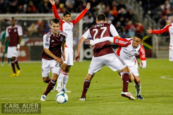 May 4th, 2013 - As Colorado Rapids midfielder Nathan Sturgis (24) breaks away with the ball, midfielder Nick LaBrocca (27) fouls Toronto FC midfielder Luis Silva (11) during the MLS match between the Toronto FC and the Colorado Rapids at Dick's Sporting Goods Park in Commerce City, CO